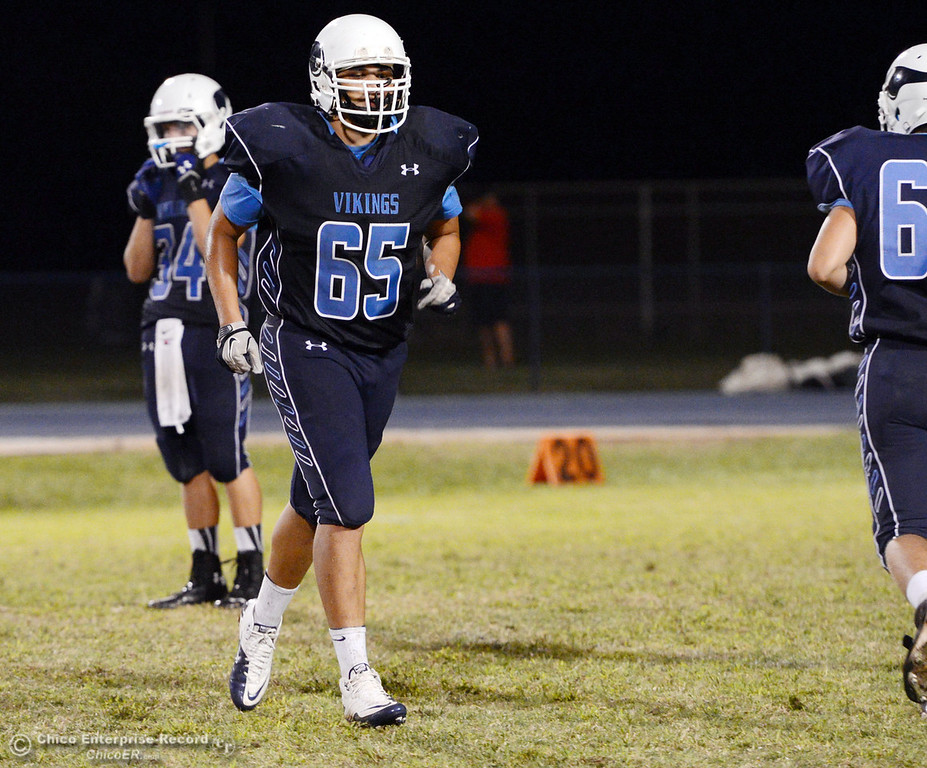 Description of . Pleasant Valley High's #65 Michael Walker against Lassen High in the third quarter of their football game at PVHS Asgard Yard Friday, September 6, 2013 in Chico, Calif. (Jason Halley/Chico Enterprise-Record)
