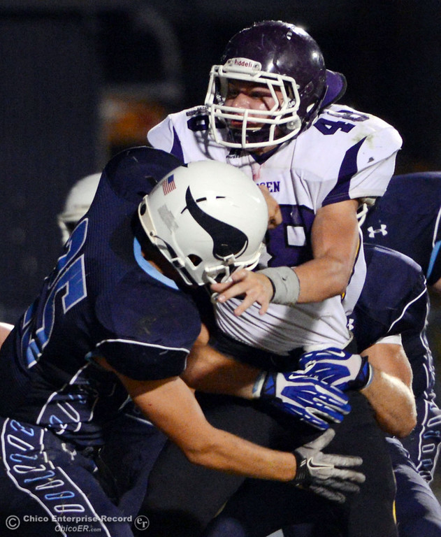 Description of . Pleasant Valley High's #25 Ryan Steindorf (left) tackles against Lassen High's #48 Kyle Barnetche (right) in the first quarter of their football game at PVHS Asgard Yard Friday, September 6, 2013 in Chico, Calif. (Jason Halley/Chico Enterprise-Record)