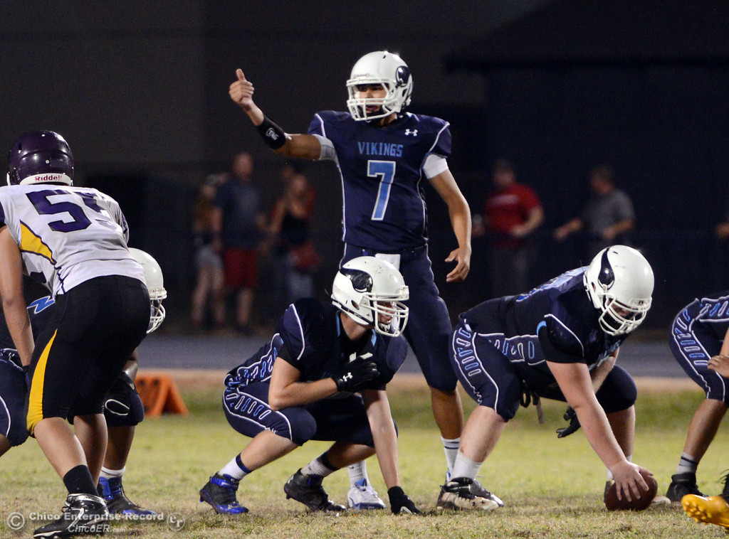 Description of . Pleasant Valley High's #7 Zane Ferguson makes the calls as quarterback against Lassen High in the fourth quarter of their football game at PVHS Asgard Yard Friday, September 6, 2013 in Chico, Calif. (Jason Halley/Chico Enterprise-Record)