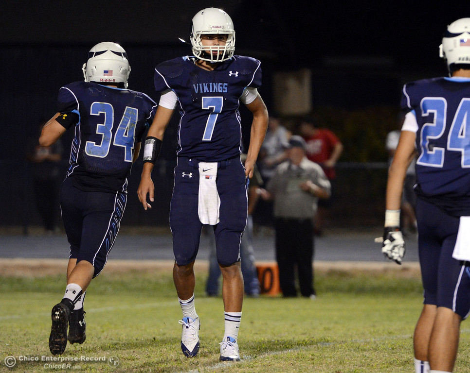 Description of . Pleasant Valley High's #7 Zane Ferguson (center) came in as quarterback against Lassen High in the fourth quarter of their football game at PVHS Asgard Yard Friday, September 6, 2013 in Chico, Calif. (Jason Halley/Chico Enterprise-Record)