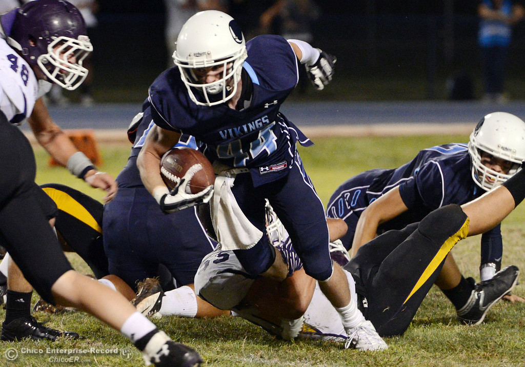 Description of . Pleasant Valley High's #44 Cyland Leitner rushes against Lassen High in the second quarter of their football game at PVHS Asgard Yard Friday, September 6, 2013 in Chico, Calif. (Jason Halley/Chico Enterprise-Record)