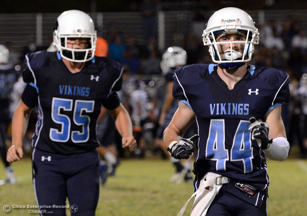 Description of . Pleasant Valley High's #55 Tucker Stimac (left) and #44 Cyland Leitner (right) against Lassen High in the third quarter of their football game at PVHS Asgard Yard Friday, September 6, 2013 in Chico, Calif. (Jason Halley/Chico Enterprise-Record)