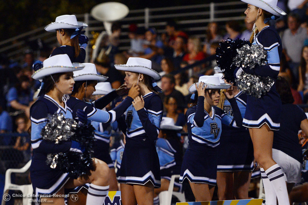 Description of . Pleasant Valley High cheerleaders put on cowboy hats as they cheer against Lassen High in the second quarter of their football game at PVHS Asgard Yard Friday, September 6, 2013 in Chico, Calif. (Jason Halley/Chico Enterprise-Record)