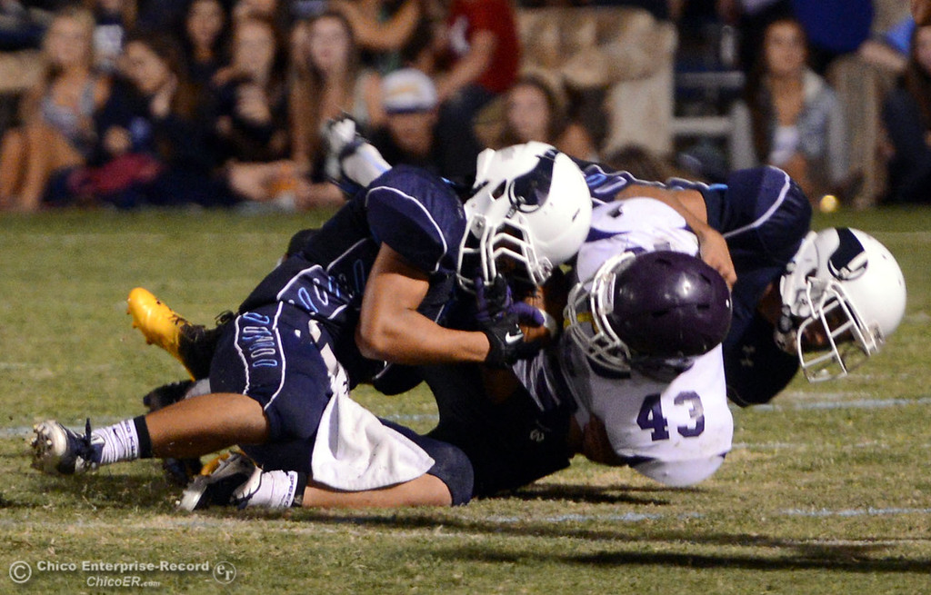 Description of . Pleasant Valley High's #3 Brandon Romero (left) and #10 Tucker LaRue (right) tackle against Lassen High's #43 Case Bennett (center) in the third quarter of their football game at PVHS Asgard Yard Friday, September 6, 2013 in Chico, Calif. (Jason Halley/Chico Enterprise-Record)