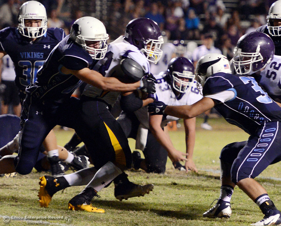 Description of . Pleasant Valley High's #88 Zack Suttles (left) and #3 Brandon Romero (right) tackle against Lassen High's #43 Case Bennett (center) in the second quarter of their football game at PVHS Asgard Yard Friday, September 6, 2013 in Chico, Calif. (Jason Halley/Chico Enterprise-Record)