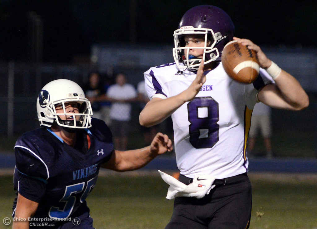 Description of . Pleasant Valley High's #55 Tucker Stimac (left) defends against Lassen High's #8 Jordan Atkinson (right) in the first quarter of their football game at PVHS Asgard Yard Friday, September 6, 2013 in Chico, Calif. (Jason Halley/Chico Enterprise-Record)