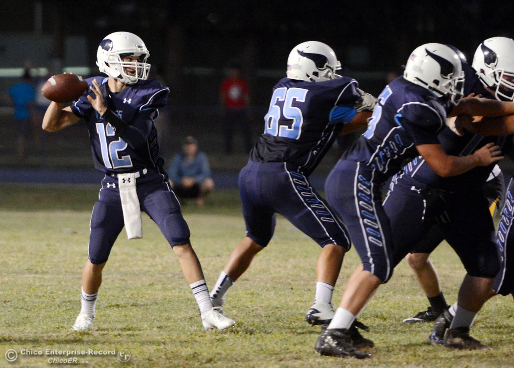 Description of . Pleasant Valley High's #12 Trent Darms throws a pass against Lassen High in the first quarter of their football game at PVHS Asgard Yard Friday, September 6, 2013 in Chico, Calif. (Jason Halley/Chico Enterprise-Record)