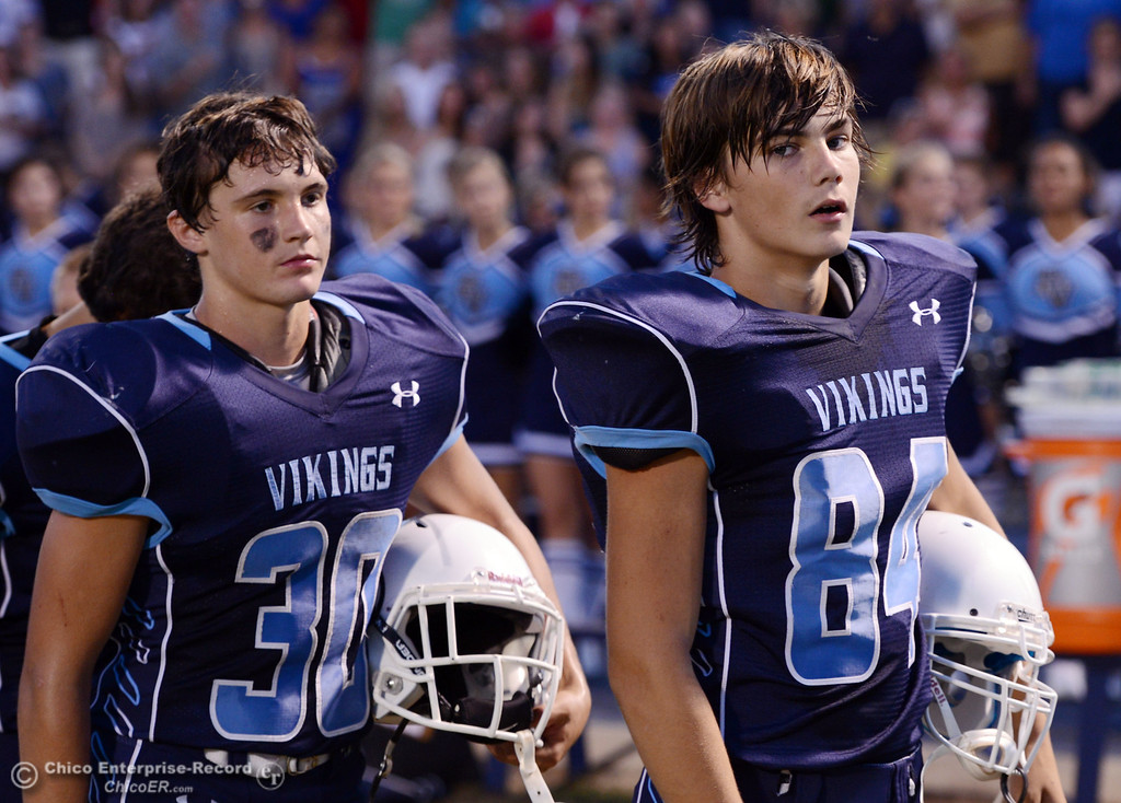 Description of . Pleasant Valley High's #30 Connor Melton (left) and #84 Charlie Bailey (right) look on against Lassen High before the first quarter of their football game at PVHS Asgard Yard Friday, September 6, 2013 in Chico, Calif. (Jason Halley/Chico Enterprise-Record)
