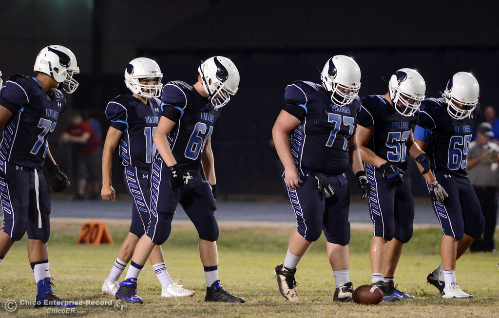 Description of . Pleasant Valley High's offensive line, #72 Christian Darden, #12 Trent Darms, #64 Chase Jacobsen, #77 Tyler Stimac, #52 Riley Andrew, and #65 Michael Walker (left to right) ready against Lassen High in the first quarter of their football game at PVHS Asgard Yard Friday, September 6, 2013 in Chico, Calif. (Jason Halley/Chico Enterprise-Record)
