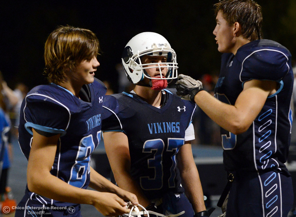 Description of . Pleasant Valley High's #84 Charlie Bailey, #37 Garett Greenwald, and and #25 Ryan Steindorf (left to right) against Lassen High in the third quarter of their football game at PVHS Asgard Yard Friday, September 6, 2013 in Chico, Calif. (Jason Halley/Chico Enterprise-Record)
