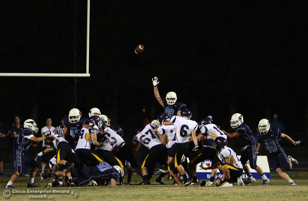 Description of . Pleasant Valley High attempts to block the extra point against Lassen High in the fourth quarter of their football game at PVHS Asgard Yard Friday, September 6, 2013 in Chico, Calif. (Jason Halley/Chico Enterprise-Record)