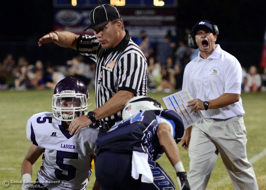 Description of . Pleasant Valley High coach Mark Cooley (right) reacts to a call against Lassen High in the second quarter of their football game at PVHS Asgard Yard Friday, September 6, 2013 in Chico, Calif. (Jason Halley/Chico Enterprise-Record)