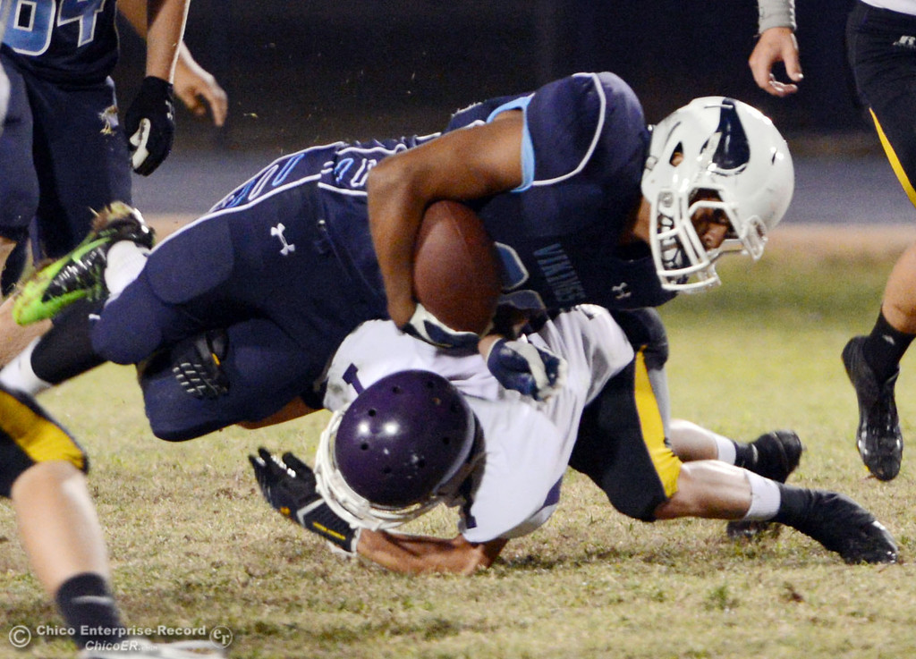 Description of . Pleasant Valley High's #20 Bryan Esquivel (top) is tackled against Lassen High's #7 Ammon Breitenstein (bottom) in the fourth quarter of their football game at PVHS Asgard Yard Friday, September 6, 2013 in Chico, Calif. (Jason Halley/Chico Enterprise-Record)