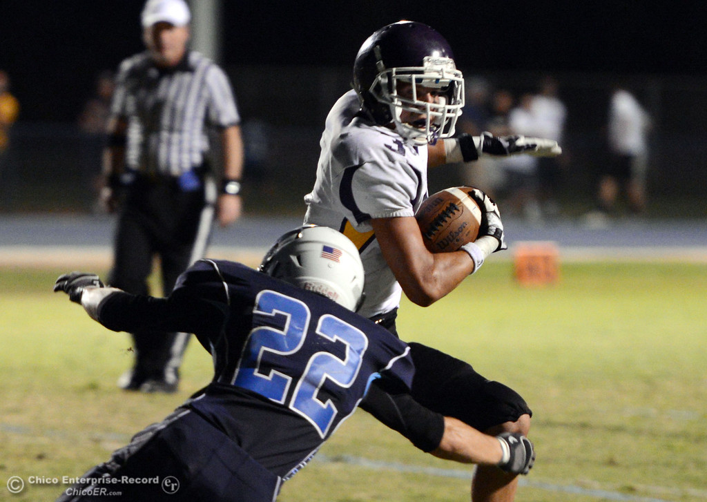 Description of . Pleasant Valley High's #22 Jake Dani (left) tackles against Lassen High's #3 Quinn Thompson (right) in the first quarter of their football game at PVHS Asgard Yard Friday, September 6, 2013 in Chico, Calif. (Jason Halley/Chico Enterprise-Record)