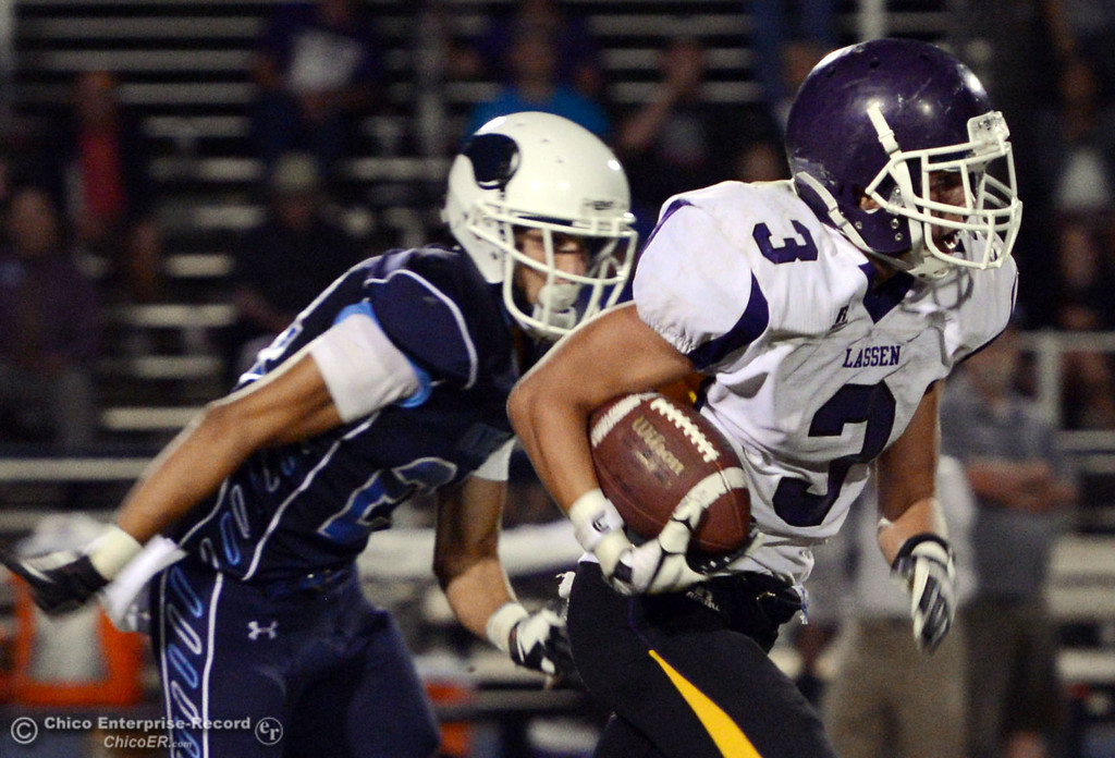 Description of . Pleasant Valley High's #24 Jack Soza (left) defends against Lassen High's #3 Quinn Thompson (right) in the third quarter of their football game at PVHS Asgard Yard Friday, September 6, 2013 in Chico, Calif. (Jason Halley/Chico Enterprise-Record)
