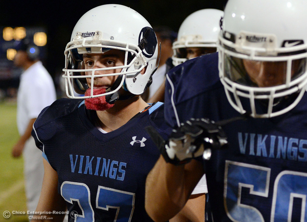 Description of . Pleasant Valley High's #37 Garett Greenwald (left) looks on against Lassen High in the third quarter of their football game at PVHS Asgard Yard Friday, September 6, 2013 in Chico, Calif. (Jason Halley/Chico Enterprise-Record)