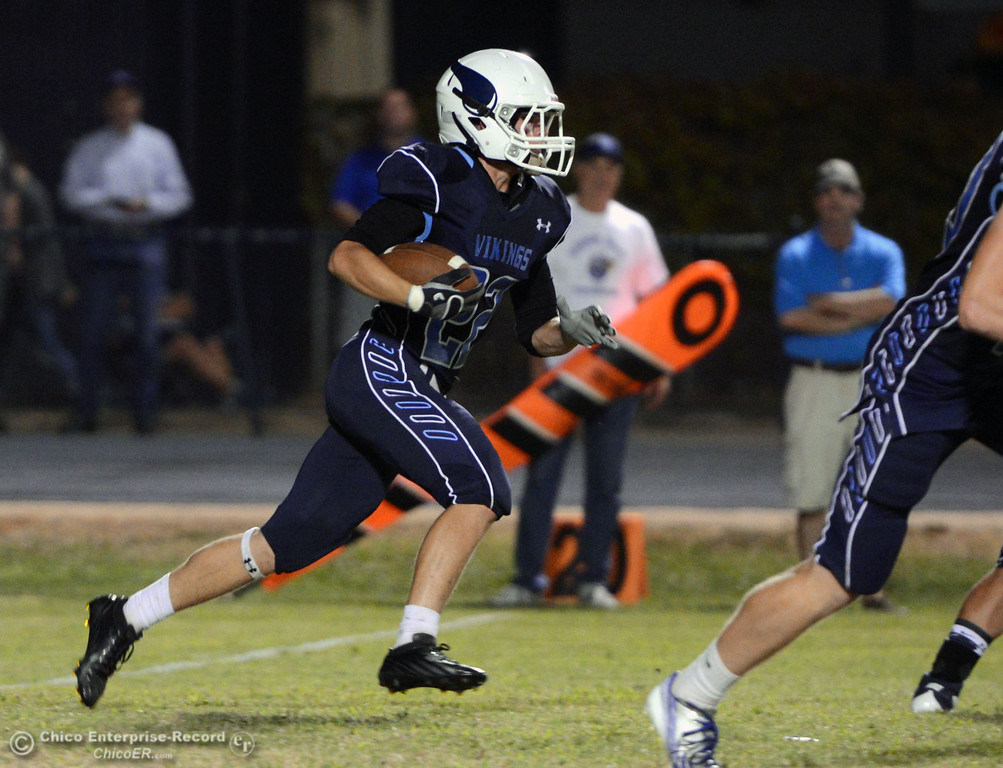 Description of . Pleasant Valley High's #22 Jake Dani rushes against Lassen High in the first quarter of their football game at PVHS Asgard Yard Friday, September 6, 2013 in Chico, Calif. (Jason Halley/Chico Enterprise-Record)