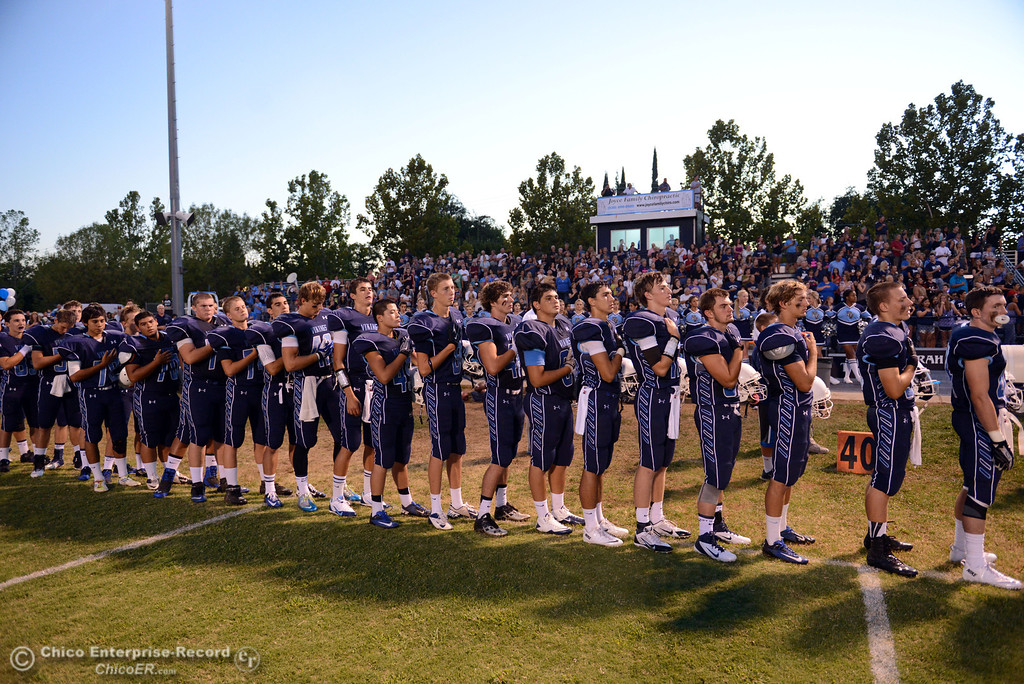 Description of . Pleasant Valley High team stands for the National Anthem against Lassen High before the first quarter of their football game at PVHS Asgard Yard Friday, September 6, 2013 in Chico, Calif. (Jason Halley/Chico Enterprise-Record)