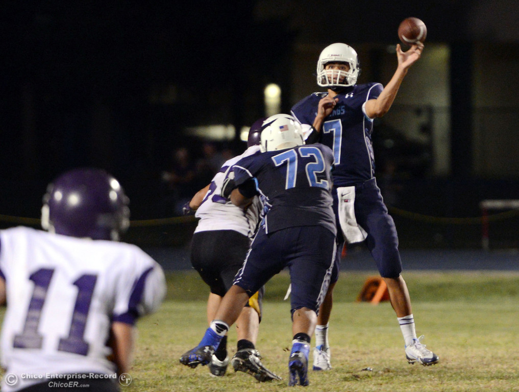 Description of . Pleasant Valley High's #7 Zane Ferguson throws a pass under pressure against Lassen High in the fourth quarter of their football game at PVHS Asgard Yard Friday, September 6, 2013 in Chico, Calif. (Jason Halley/Chico Enterprise-Record)