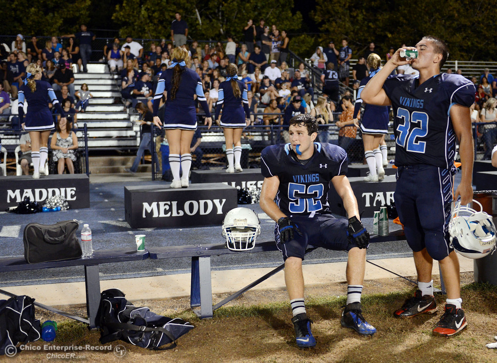 Description of . Pleasant Valley High's #52 Riley Andrew (left) and #32 Jon Acevedo (right) on the sidelines against Lassen High in the third quarter of their football game at PVHS Asgard Yard Friday, September 6, 2013 in Chico, Calif. (Jason Halley/Chico Enterprise-Record)