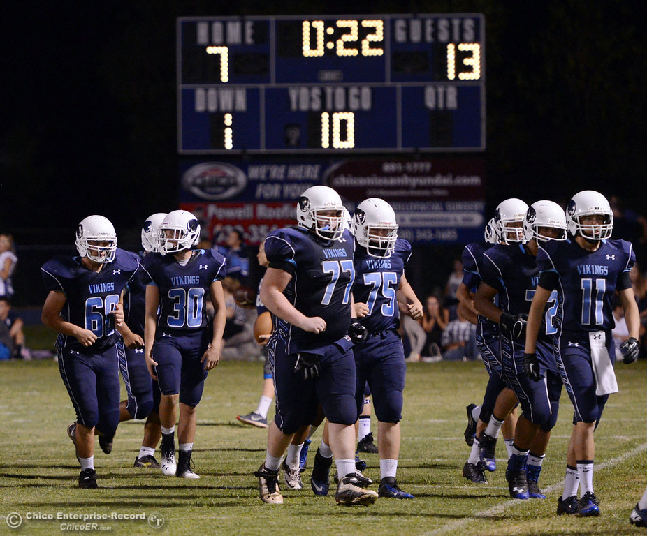 Description of . Pleasant Valley High team takes the field against Lassen High in the third quarter of their football game at PVHS Asgard Yard Friday, September 6, 2013 in Chico, Calif. (Jason Halley/Chico Enterprise-Record)