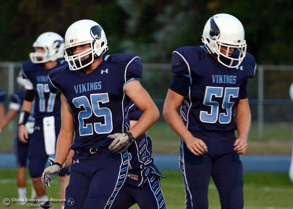 Description of . Pleasant Valley High's #25 Ryan Steindorf (left) and #55 Tucker Stimac (right) warm up against Lassen High before the first quarter of their football game at PVHS Asgard Yard Friday, September 6, 2013 in Chico, Calif. (Jason Halley/Chico Enterprise-Record)