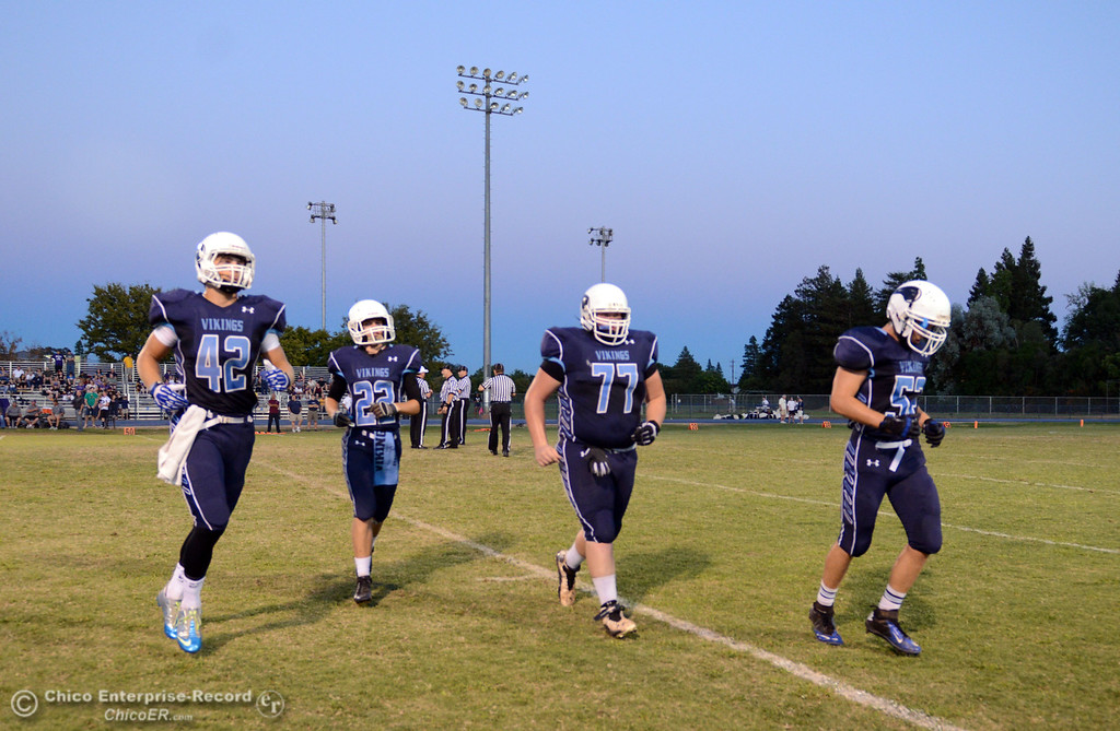 Description of . Pleasant Valley High's #42 Chad Olsen, #22 Jake Dani, #77 Tyler Stimac, and #52 Riley Andrew (left to right) ready against Lassen High before the first quarter of their football game at PVHS Asgard Yard Friday, September 6, 2013 in Chico, Calif. (Jason Halley/Chico Enterprise-Record)