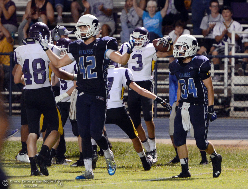 Description of . Pleasant Valley High's #42 Chad Olsen (left) and #34 Cale Crawford (right) react to an intercept by Lassen High's #3 Quinn Thompson (back) in the fourth quarter of their football game at PVHS Asgard Yard Friday, September 6, 2013 in Chico, Calif. (Jason Halley/Chico Enterprise-Record)