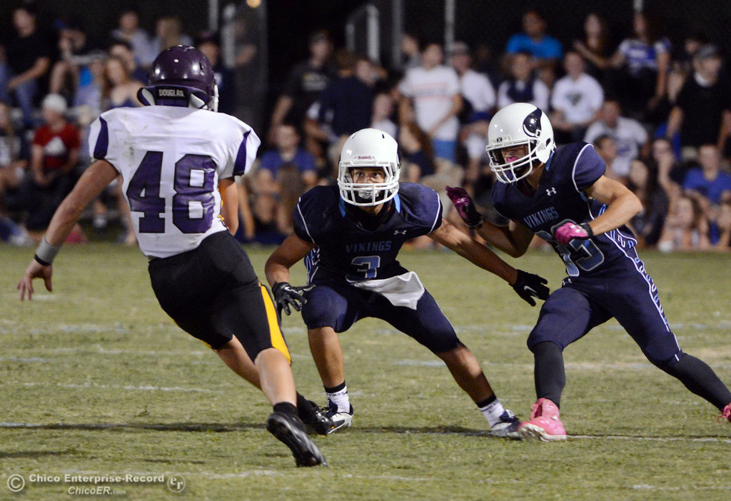 Description of . Pleasant Valley High's #3 Brandon Romero (center) and #33 Taylor Wright (right) defend against Lassen High's #48 Kyle Barnetche (left) in the second quarter of their football game at PVHS Asgard Yard Friday, September 6, 2013 in Chico, Calif. (Jason Halley/Chico Enterprise-Record)