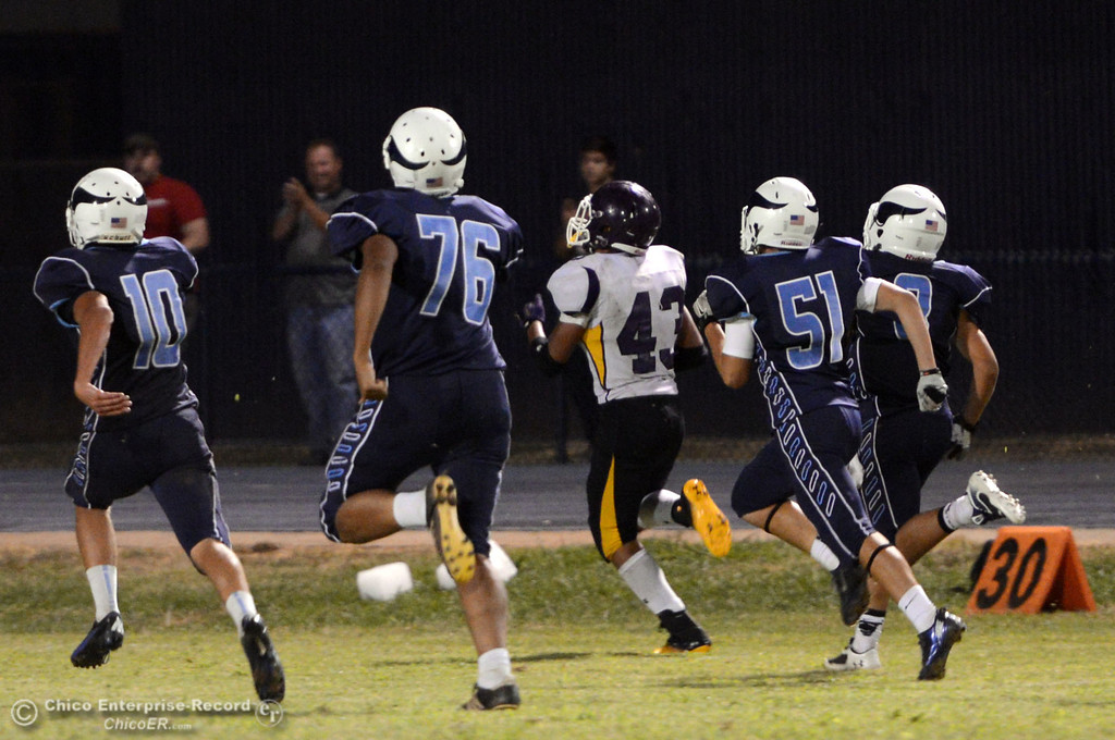 Description of . Pleasant Valley High can't stop against Lassen High's #43 Case Bennett touchdown run in the fourth quarter of their football game at PVHS Asgard Yard Friday, September 6, 2013 in Chico, Calif. (Jason Halley/Chico Enterprise-Record)