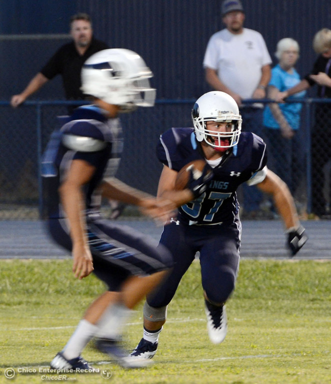Description of . Pleasant Valley High's #37 Garett Greenwald (right) rushes against Lassen High in the first quarter of their football game at PVHS Asgard Yard Friday, September 6, 2013 in Chico, Calif. (Jason Halley/Chico Enterprise-Record)