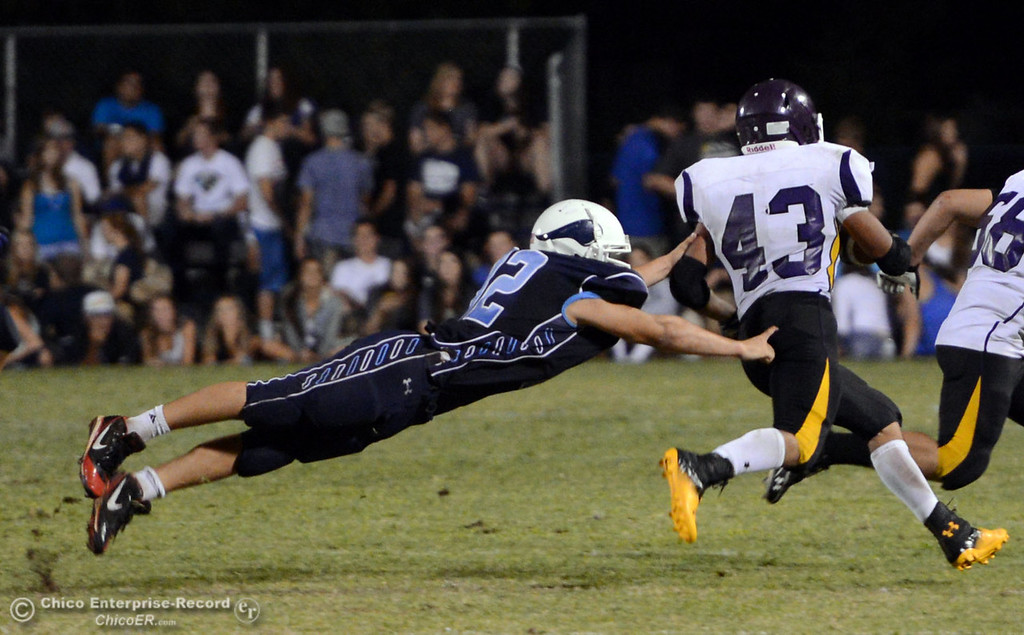 Description of . Pleasant Valley High's #32 Jon Acevedo (left) attempts to tackle against Lassen High's #43 Case Bennett (right) in the second quarter of their football game at PVHS Asgard Yard Friday, September 6, 2013 in Chico, Calif. (Jason Halley/Chico Enterprise-Record)