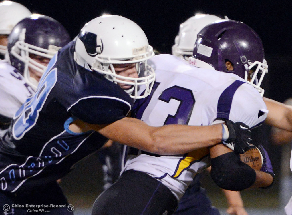 Description of . Pleasant Valley High's #88 Zack Stuttles (left) tackles against Lassen High's #43 Case Bennett (right) in the second quarter of their football game at PVHS Asgard Yard Friday, September 6, 2013 in Chico, Calif. (Jason Halley/Chico Enterprise-Record)