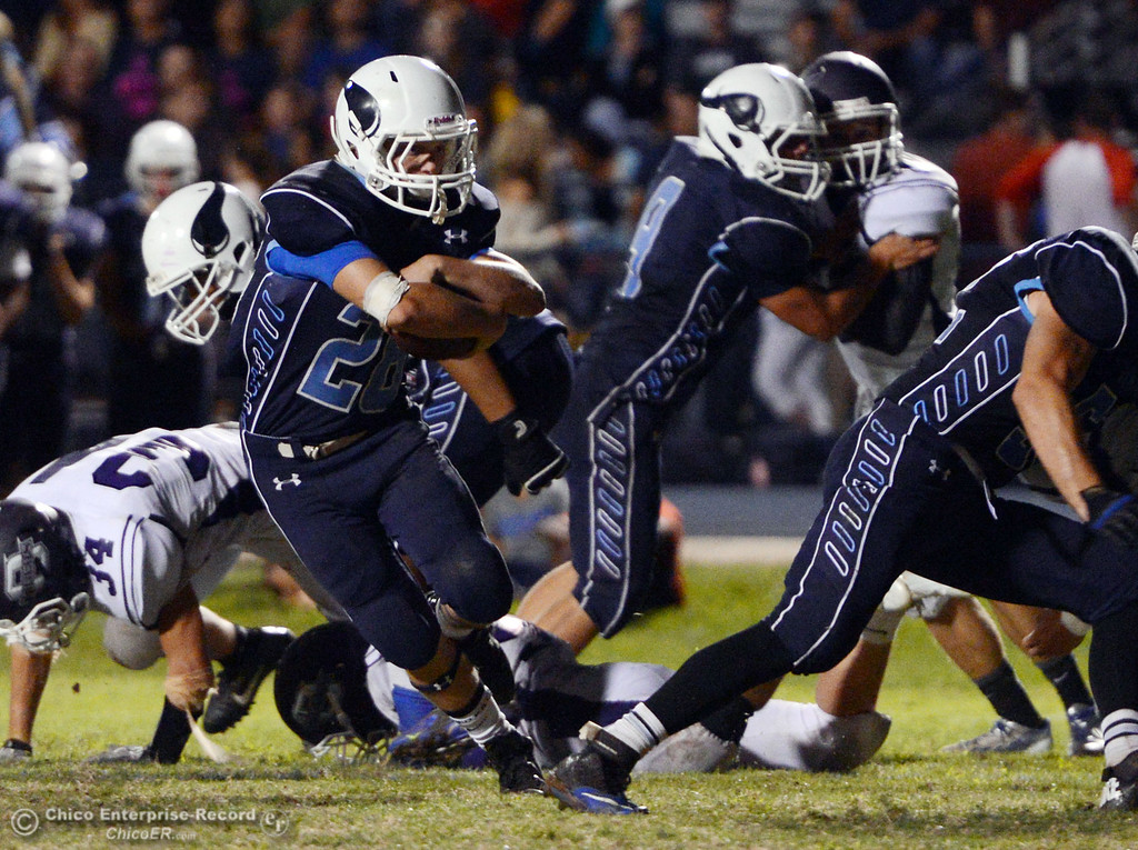 Description of . Pleasant Valley High\'s #28 Dylan Batie (left) rushes) against Oroville High in the third quarter of their football game at PVHS Asgard Yard Friday, September 20, 2013, in Chico, Calif. (Jason Halley/Chico Enterprise-Record)