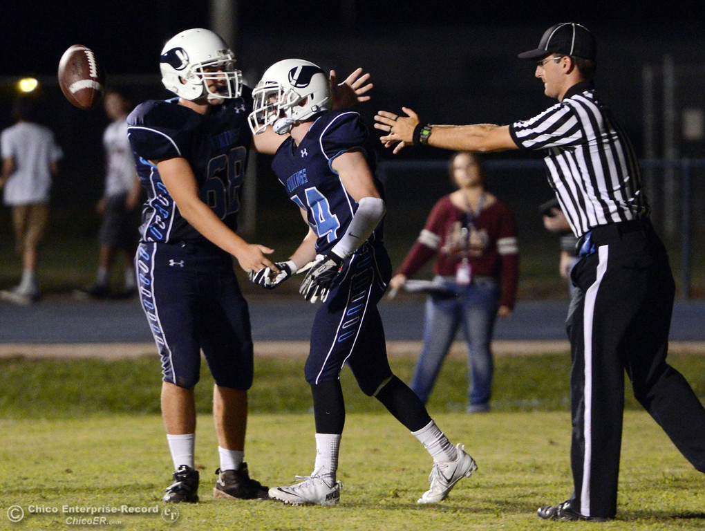 Description of . Pleasant Valley High\'s #68 Jacob Gregg (left) congratulates #44 Clyand Leitner (right) on scoring a touchdown against Oroville High in the second quarter of their football game at PVHS Asgard Yard Friday, September 20, 2013, in Chico, Calif. (Jason Halley/Chico Enterprise-Record)