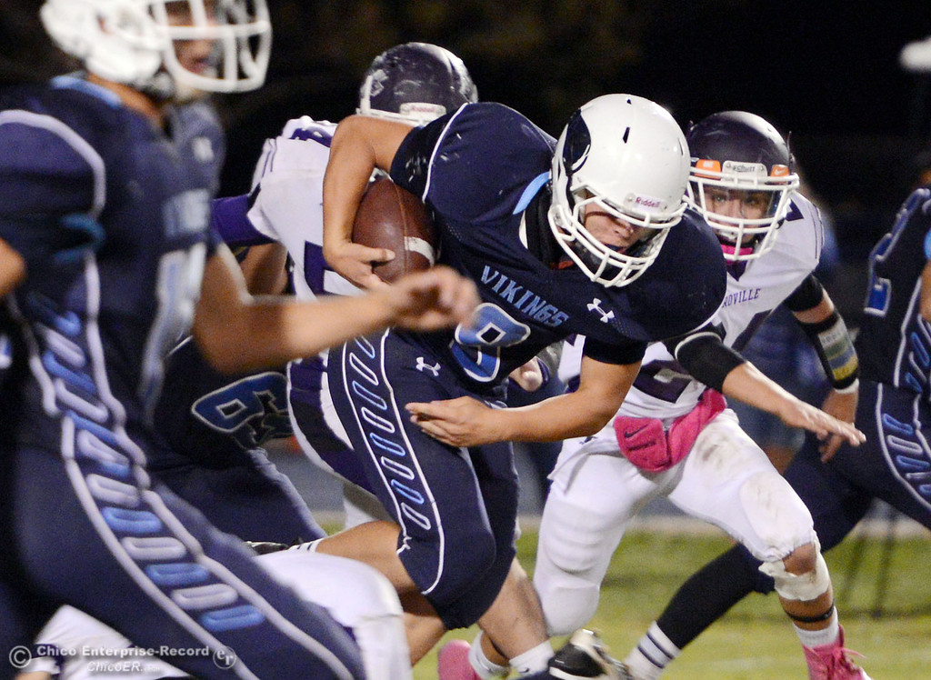 Description of . Pleasant Valley High\'s #9 Houston McGowan (right) rushes against Oroville High in the third quarter of their football game at PVHS Asgard Yard Friday, September 20, 2013, in Chico, Calif. (Jason Halley/Chico Enterprise-Record)