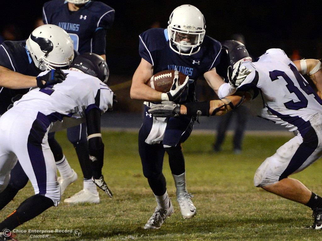 Description of . Pleasant Valley High\'s #44 Cyland Leitner (center) rushes against Oroville High\'s #1 Michael Ripley (left) and #34 Thomas Miller (right) in the third quarter of their football game at PVHS Asgard Yard Friday, September 20, 2013, in Chico, Calif. (Jason Halley/Chico Enterprise-Record)