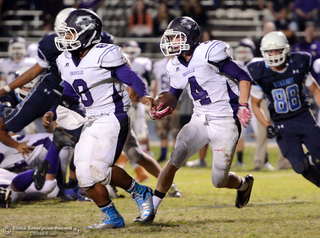 Description of . Pleasant Valley High against Oroville High\'s #8 James Jones (left) screens for #4 Antony Ramsey (right) in the second quarter of their football game at PVHS Asgard Yard Friday, September 20, 2013, in Chico, Calif. (Jason Halley/Chico Enterprise-Record)