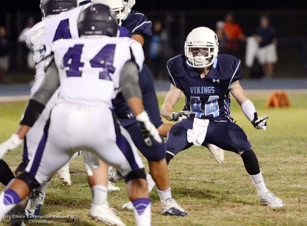 Description of . Pleasant Valley High\'s #44 Cyland Leitner (right) holds the line against Oroville High in the first quarter of their football game at PVHS Asgard Yard Friday, September 20, 2013, in Chico, Calif. (Jason Halley/Chico Enterprise-Record)