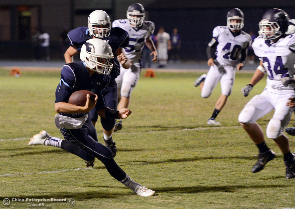 Description of . Pleasant Valley High\'s #12 Trent Darms rushes against Oroville High in the second quarter of their football game at PVHS Asgard Yard Friday, September 20, 2013, in Chico, Calif. (Jason Halley/Chico Enterprise-Record)
