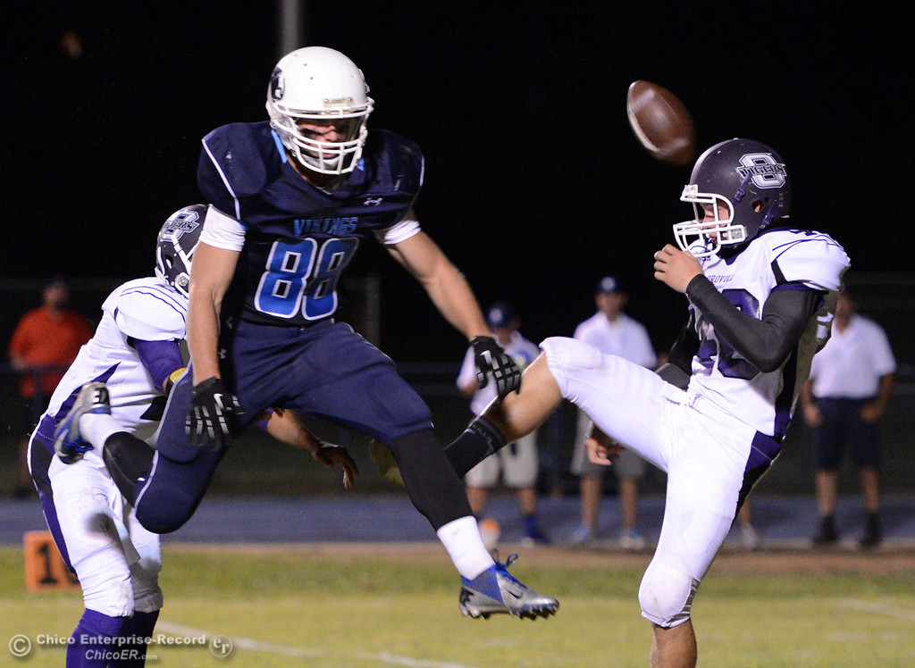 . Pleasant Valley High\'s #88 Zack Suttles (left) blocks a punt against Oroville High\'s #40 Taner Dubie (right) in the second quarter of their football game at PVHS Asgard Yard Friday, September 20, 2013, in Chico, Calif. (Jason Halley/Chico Enterprise-Record)