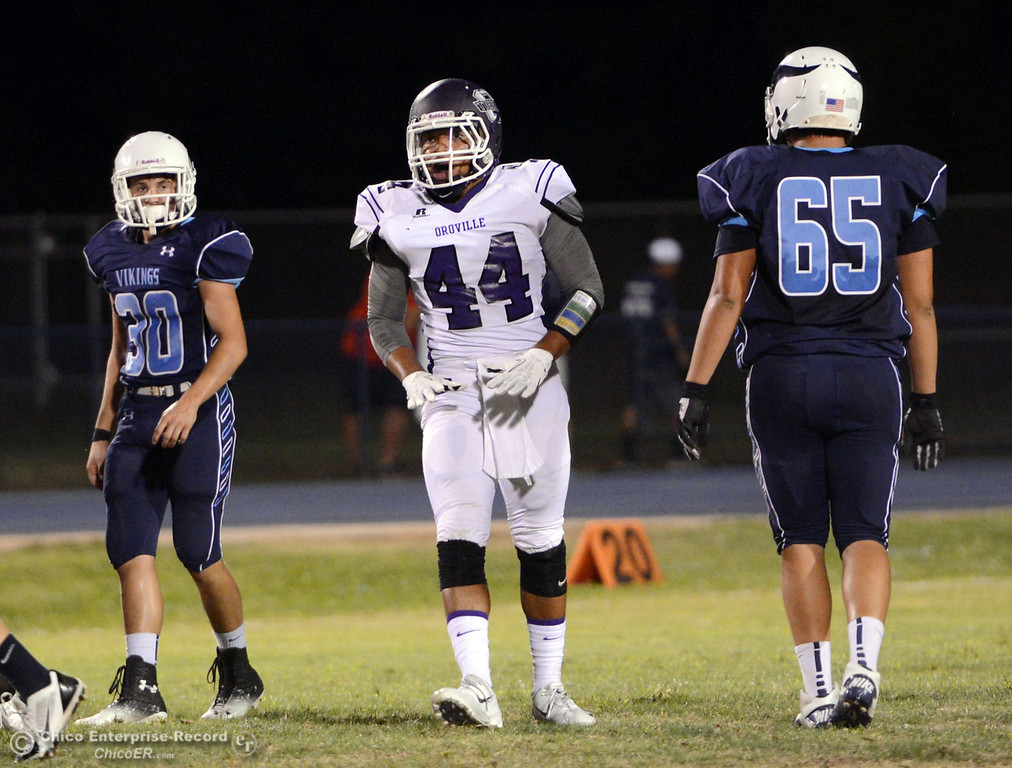 Description of . Pleasant Valley High\'s #30 Connor Melton (left) and #65 Michael Walker (right) against Oroville High\'s #44 Derrek Gordon (center) in the first quarter of their football game at PVHS Asgard Yard Friday, September 20, 2013, in Chico, Calif. (Jason Halley/Chico Enterprise-Record)