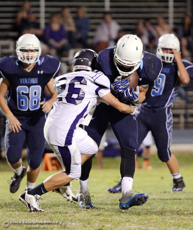 Description of . Pleasant Valley High\'s #42 Chad Olsen (right) is tackled against Oroville High\'s #26 Dylan Shoemaker (left) in the first quarter of their football game at PVHS Asgard Yard Friday, September 20, 2013, in Chico, Calif. (Jason Halley/Chico Enterprise-Record)