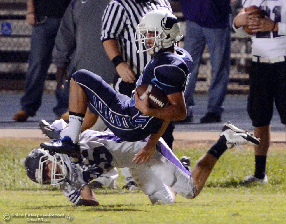 Description of . Pleasant Valley High\'s #10 Tucker Larue (top) is tackled against Oroville High\'s #26 Dylan Shoemaker (bottom) in the second quarter of their football game at PVHS Asgard Yard Friday, September 20, 2013, in Chico, Calif. (Jason Halley/Chico Enterprise-Record)