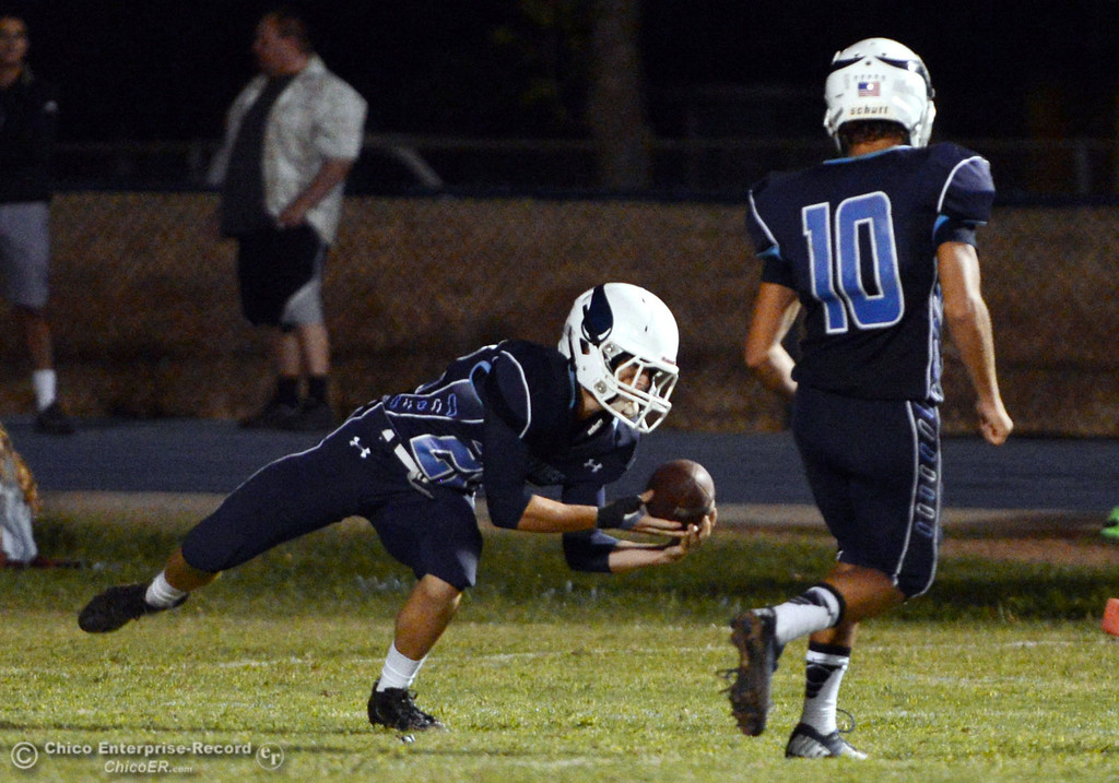 Description of . Pleasant Valley High\'s #22 Jake Dani picks up a punt against Oroville High in the third quarter of their football game at PVHS Asgard Yard Friday, September 20, 2013, in Chico, Calif. (Jason Halley/Chico Enterprise-Record)
