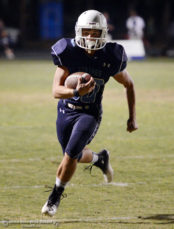 Description of . Pleasant Valley High\'s #30 Connor Melton rushes for a touchdown against Oroville High in the second quarter of their football game at PVHS Asgard Yard Friday, September 20, 2013, in Chico, Calif. (Jason Halley/Chico Enterprise-Record)