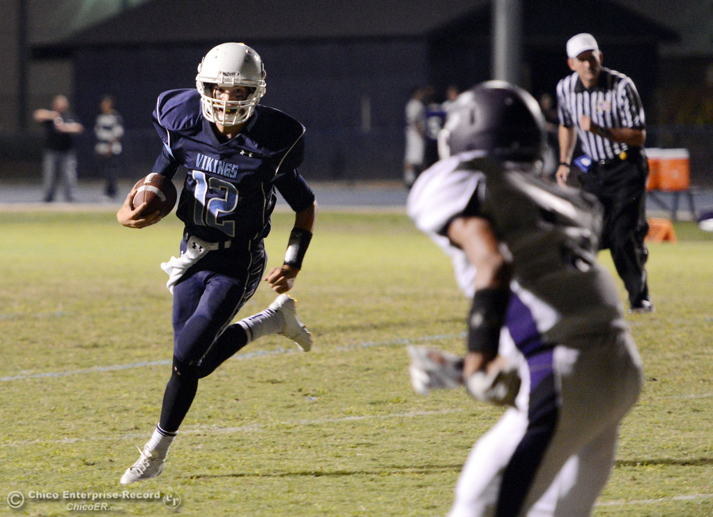 Description of . Pleasant Valley High\'s #12 Trent Darms (left) rushes against Oroville High in the second quarter of their football game at PVHS Asgard Yard Friday, September 20, 2013, in Chico, Calif. (Jason Halley/Chico Enterprise-Record)