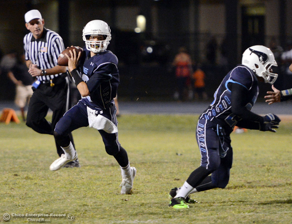 Description of . Pleasant Valley High\'s #12 Trent Darms scrambles against Oroville High in the second quarter of their football game at PVHS Asgard Yard Friday, September 20, 2013, in Chico, Calif. (Jason Halley/Chico Enterprise-Record)