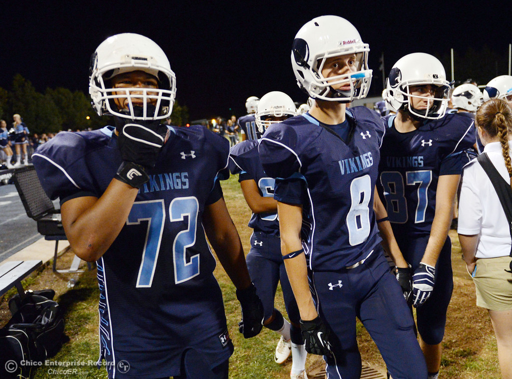 Description of . Pleasant Valley High\'s #72 Christian Darden (left) and #8 Brandon Bierman (right) against Oroville High in the second quarter of their football game at PVHS Asgard Yard Friday, September 20, 2013, in Chico, Calif. (Jason Halley/Chico Enterprise-Record)