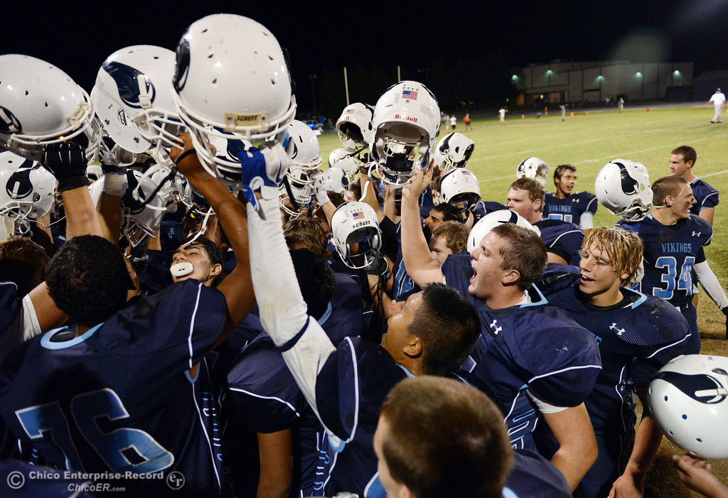 Description of . Pleasant Valley High celebrates their win against Oroville High in their football game at PVHS Asgard Yard Friday, September 20, 2013, in Chico, Calif. (Jason Halley/Chico Enterprise-Record)
